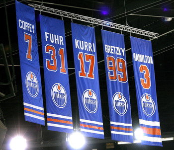 EDMONTON, CANADA - OCTOBER 18:  The number 7 Paul Coffey Retirement banner takes its place in the rafters beside those of Edmonton Oilers greats Grant Fuhr, Jari Kurri, Wayne Gretzky and Al Hamilton, during a special ceremony honouring Paul Coffey on Octo