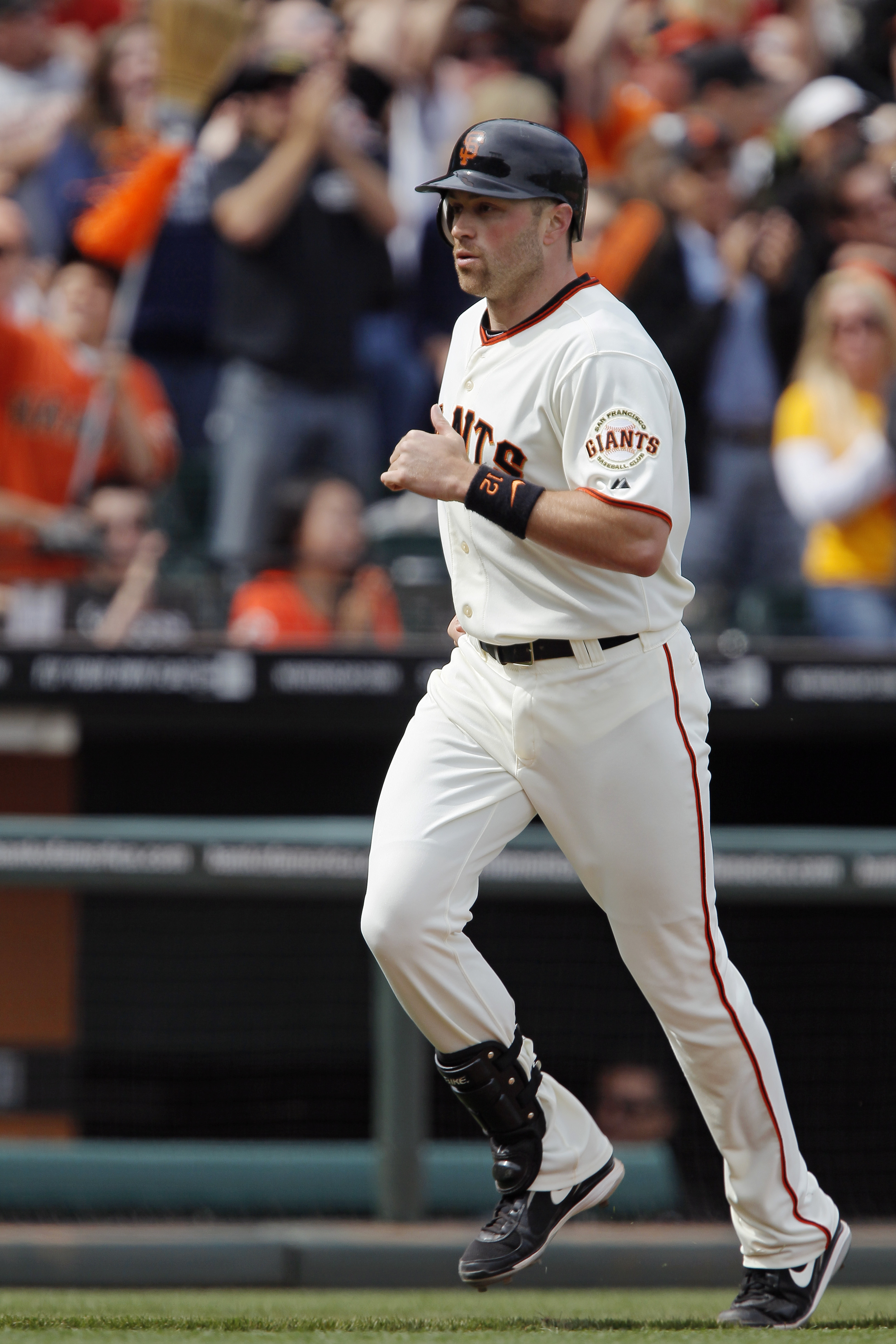 SAN FRANCISCO, CA - MAY 22:  Nate Schierholtz #12 of the San Francisco Giants rounds the bases on a two-run home run to tie the game against the Oakland A's in the eighth inning at AT&T Park on May 22, 2011 in San Francisco, California.  The Giants won 5-
