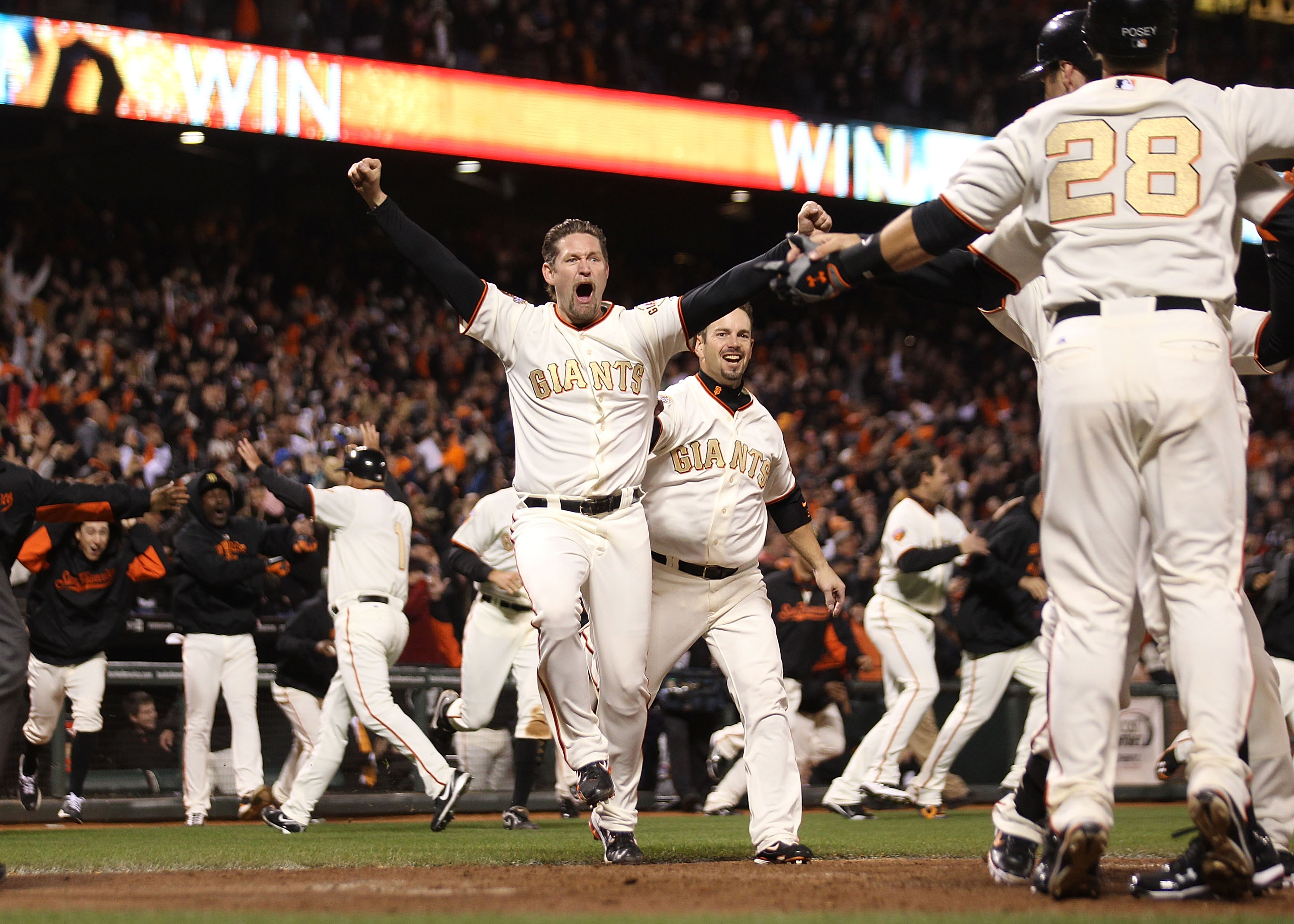 SAN FRANCISCO, CA - APRIL 09:  Aubrey Huff #17 celebrates after Miguel Tejada of the San Francisco Giants hit the game winning hit in the ninth inning against the St. Louis Cardinals at AT&T Park on April 9, 2011 in San Francisco, California.  (Photo by J