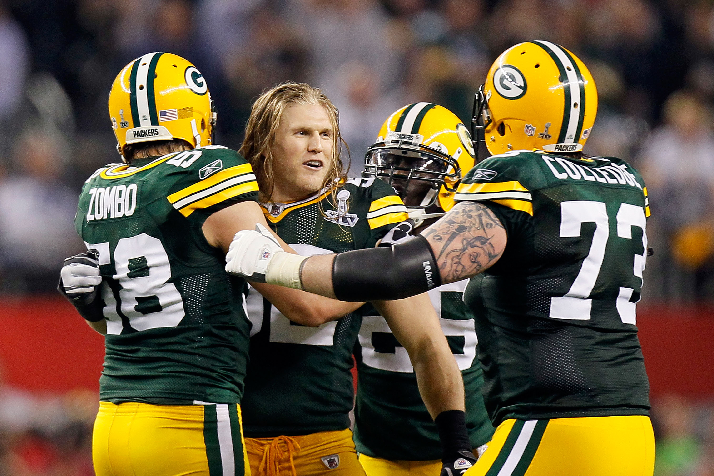 ARLINGTON, TX - FEBRUARY 06:  Clay Matthews #52 of the Green Bay Packers celebrates with teammates Frank Zombo #58 and Daryn Colledge #73 in the final minute of the Packers 31-25 win against the Pittsburgh Steelers during Super Bowl XLV at Cowboys Stadium