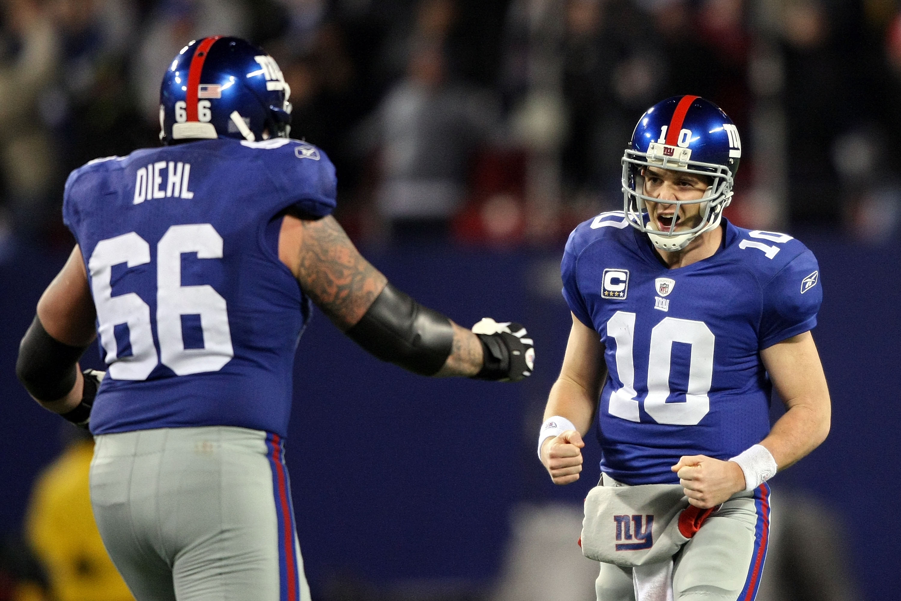 EAST RUTHERFORD, NJ - DECEMBER 13:  Eli Manning #10 of the New York Giants celebrates with David Diehl #66 after a touchdown pass in the third quarter against the Philadelphia Eagles at Giants Stadium on December 13, 2009 in East Rutherford, New Jersey.