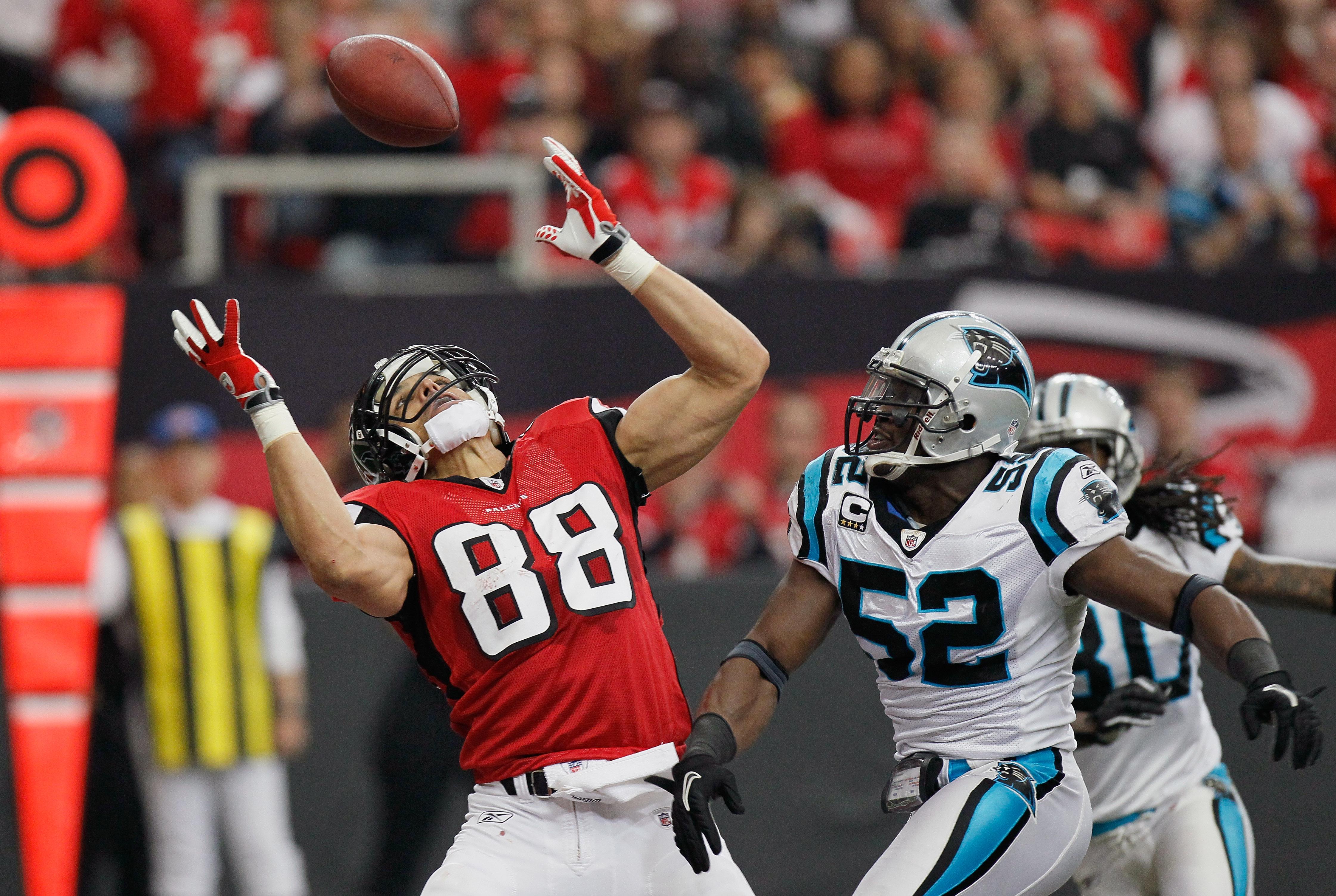 ATLANTA, GA - JANUARY 02:  Tony Gonzalez #88 of the Atlanta Falcons has this touchdown reception broken up by Jon Beason #52 of the Carolina Panthers at Georgia Dome on January 2, 2011 in Atlanta, Georgia.  (Photo by Kevin C. Cox/Getty Images)