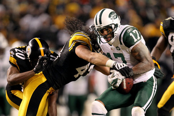 PITTSBURGH, PA - JANUARY 23:  Braylon Edwards #17 of the New York Jets is tackled by Troy Polamalu #43 of the Pittsburgh Steelers during the 2011 AFC Championship game at Heinz Field on January 23, 2011 in Pittsburgh, Pennsylvania.  (Photo by Ronald Marti
