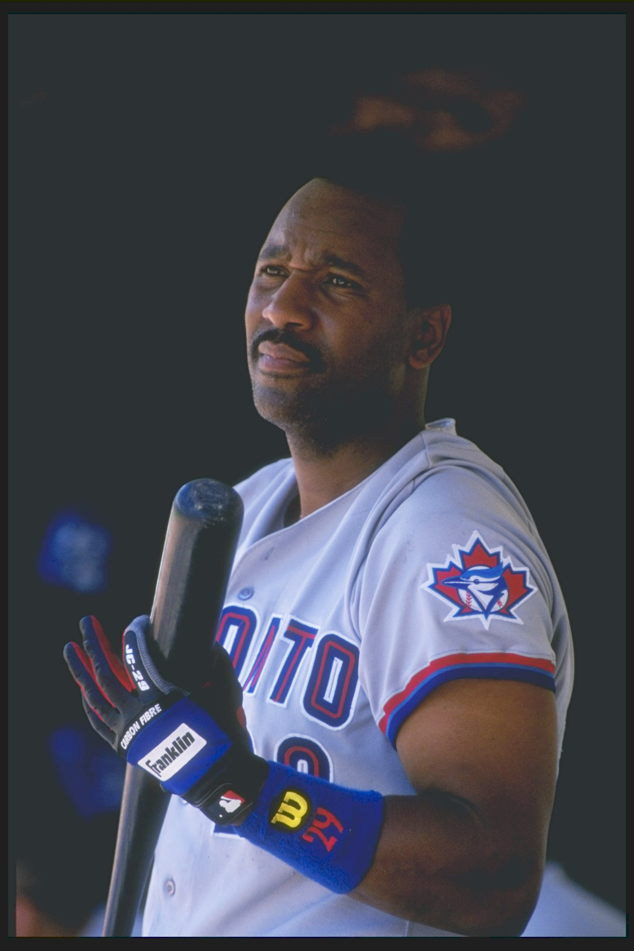 31 May 1997:  Infielder Joe Carter of the Toronto Blue Jays looks on during a game against the Oakland Athletics at the Oakland-Alameda County Coliseum in Oakland, California.  The Blue Jays won the game, 13-3. Mandatory Credit: Otto Greule  /Allsport