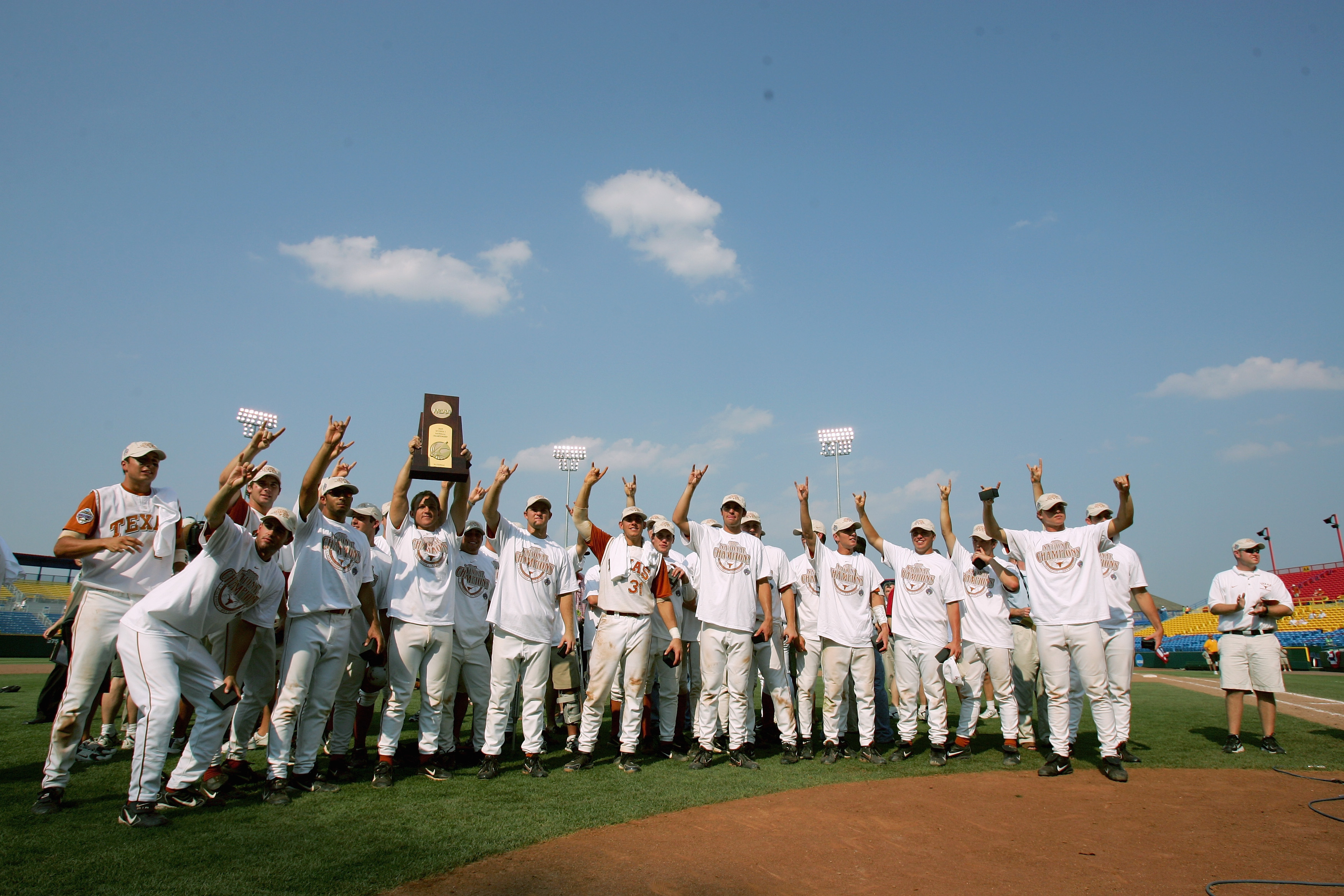 OMAHA, NE - JUNE 26:  Members of the Texas Longhorns celebrate after defeating the Florida Gators 6-2 during Game 2 of the championship series of the 59th College World Series at Rosenblatt Stadium on June 26, 2005 in Omaha, Nebraska.  (Photo by Jed Jacob