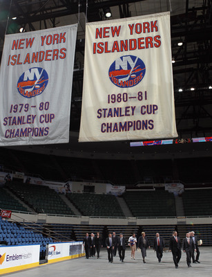UNIONDALE, NY - MAY 11:  New York Islanders owner Charles Wang and Nassau County Executive Edward Mangano arrive to announce a referendum that will build a new arena and keep the Islanders in place through 2045 during a press conference at the Nassau Vete