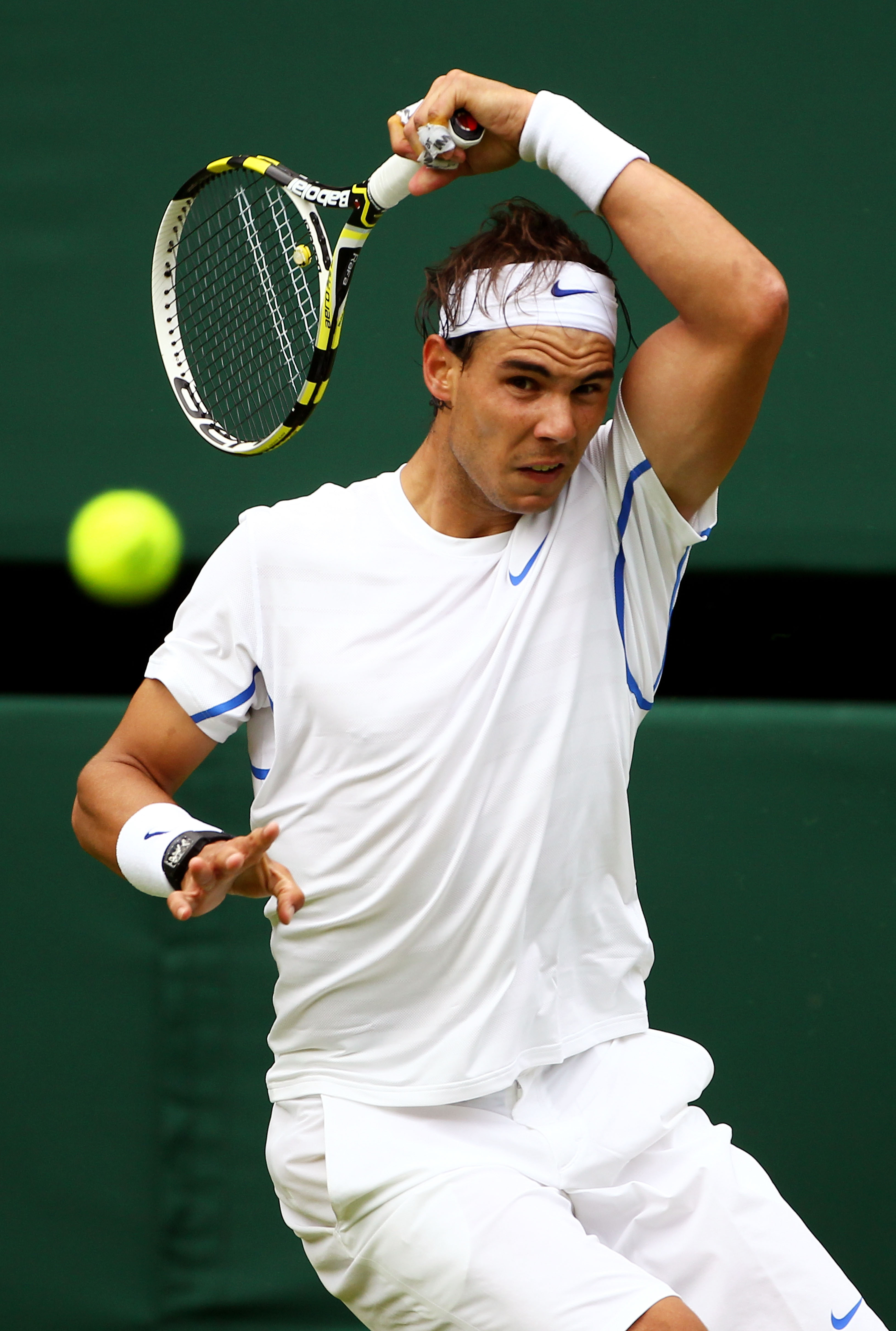 LONDON, ENGLAND - JUNE 20:  Rafael Nadal of Spain returns a shot during his first round match against Michael Russell of the United States on Day One of the Wimbledon Lawn Tennis Championships at the All England Lawn Tennis and Croquet Club on June 20, 20