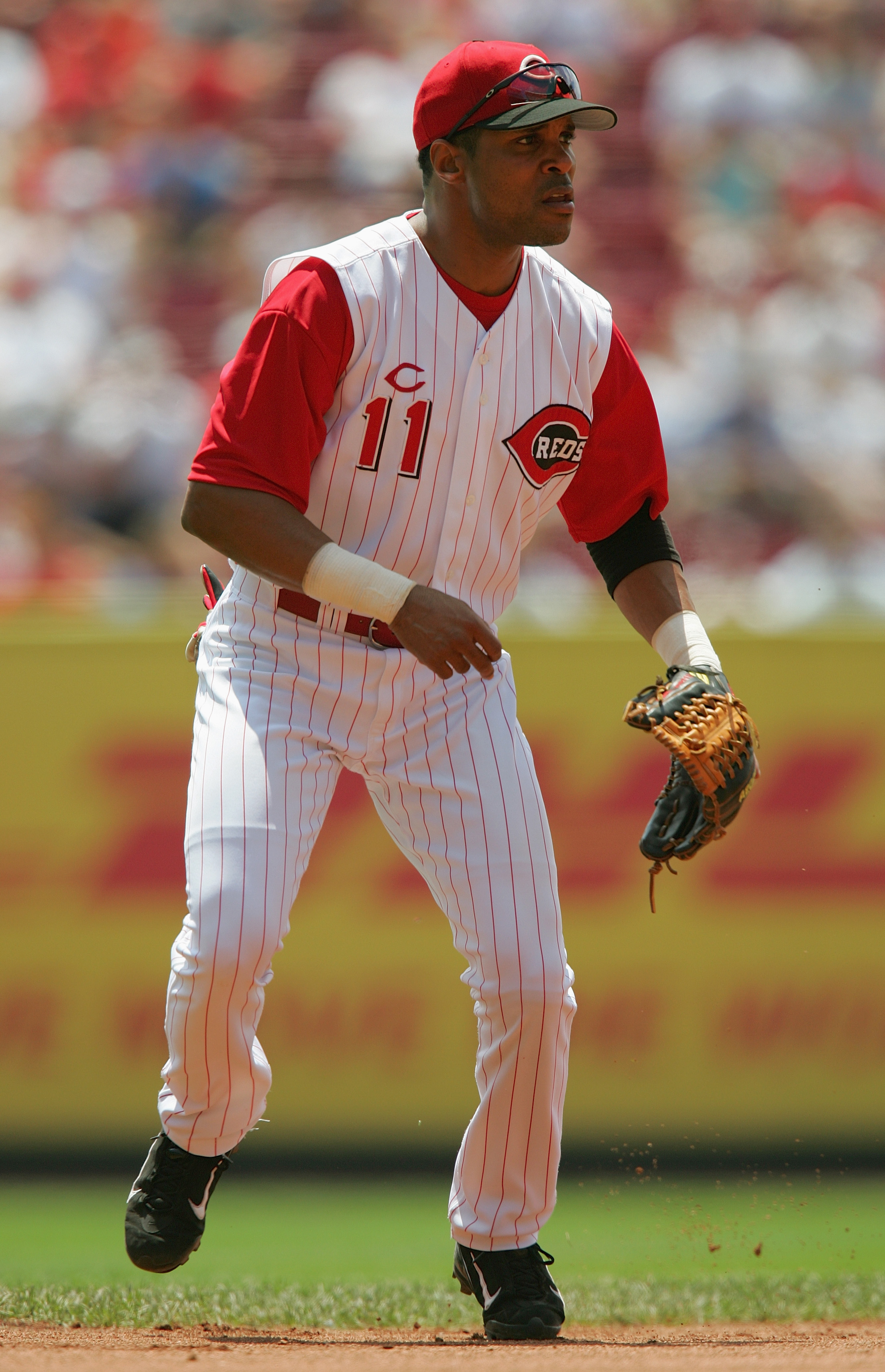 CINCINNATI, OH - JUNE 17:  Barry Larkin #11 of the Cincinnati Reds focuses on home plate as he prepares for a play during the interleague game against the Texas Rangers at the Great American Ball Park on June 17, 2004 in Cincinnati, Ohio.  The Reds defeat
