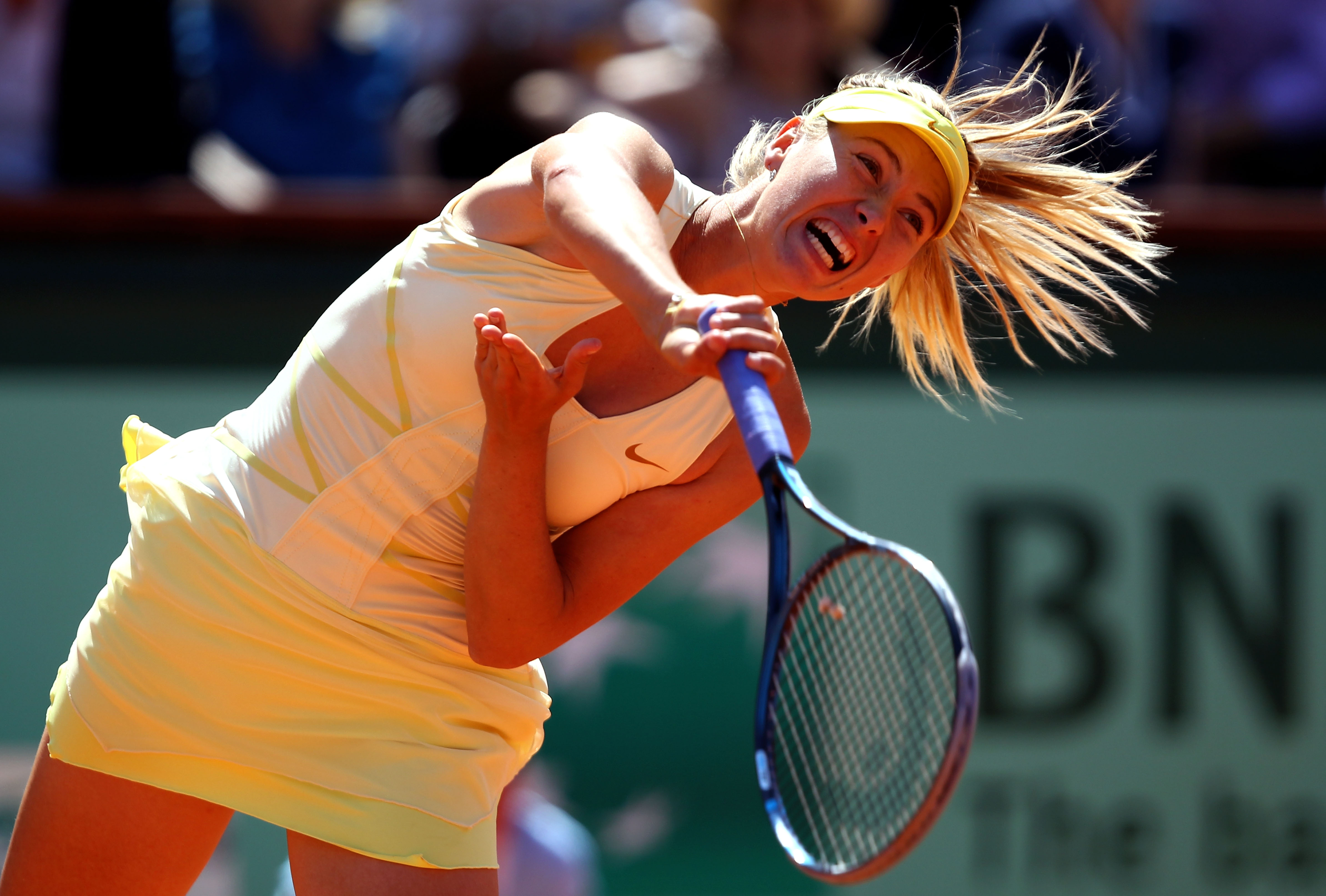 PARIS, FRANCE - JUNE 02:  Maria Sharapova of Russia serves during the women's singles semi final match between Na Li of China and Maria Sharapova of Russia on day twelve of the French Open at Roland Garros on June 2, 2011 in Paris, France.  (Photo by Cliv