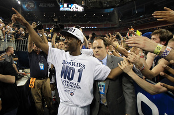 HOUSTON, TX - APRIL 04:  Kemba Walker #15 of the Connecticut Huskies walks off the court after defeating the Butler Bulldogs to win the National Championship Game of the 2011 NCAA Division I Men's Basketball Tournament by a score of 53-41 at Reliant Stadi