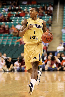 GREENSBORO, NC - MARCH 10:  Iman Shumpert #1 of the Georgia Tech Yellow Jackets dribbles down the court during the second half of the game against the Virginia Tech Hokies in the first round of the 2011 ACC men's basketball tournament at the Greensboro Co