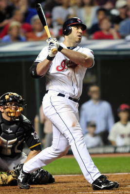 CLEVELAND, OH - JUNE 17:  Travis Hafner #48 of the Cleveland Indians watches an RBI double during the eighth inning against the Pittsburgh Pirates at Progressive Field on June 17, 2011 in Cleveland, Ohio. The Indians defeated the Pirates 5-1. (Photo by Ja