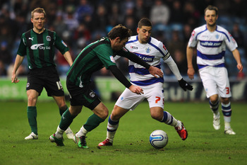 LONDON, ENGLAND - JANUARY 23:  Adel Taarabt of QPR holds off Michael Doyle of Coventry during the npower Championship match between Queens Park Rangers and Coventry City at Loftus Road on January 23, 2011 in London, England.  (Photo by Dean Mouhtaropoulos
