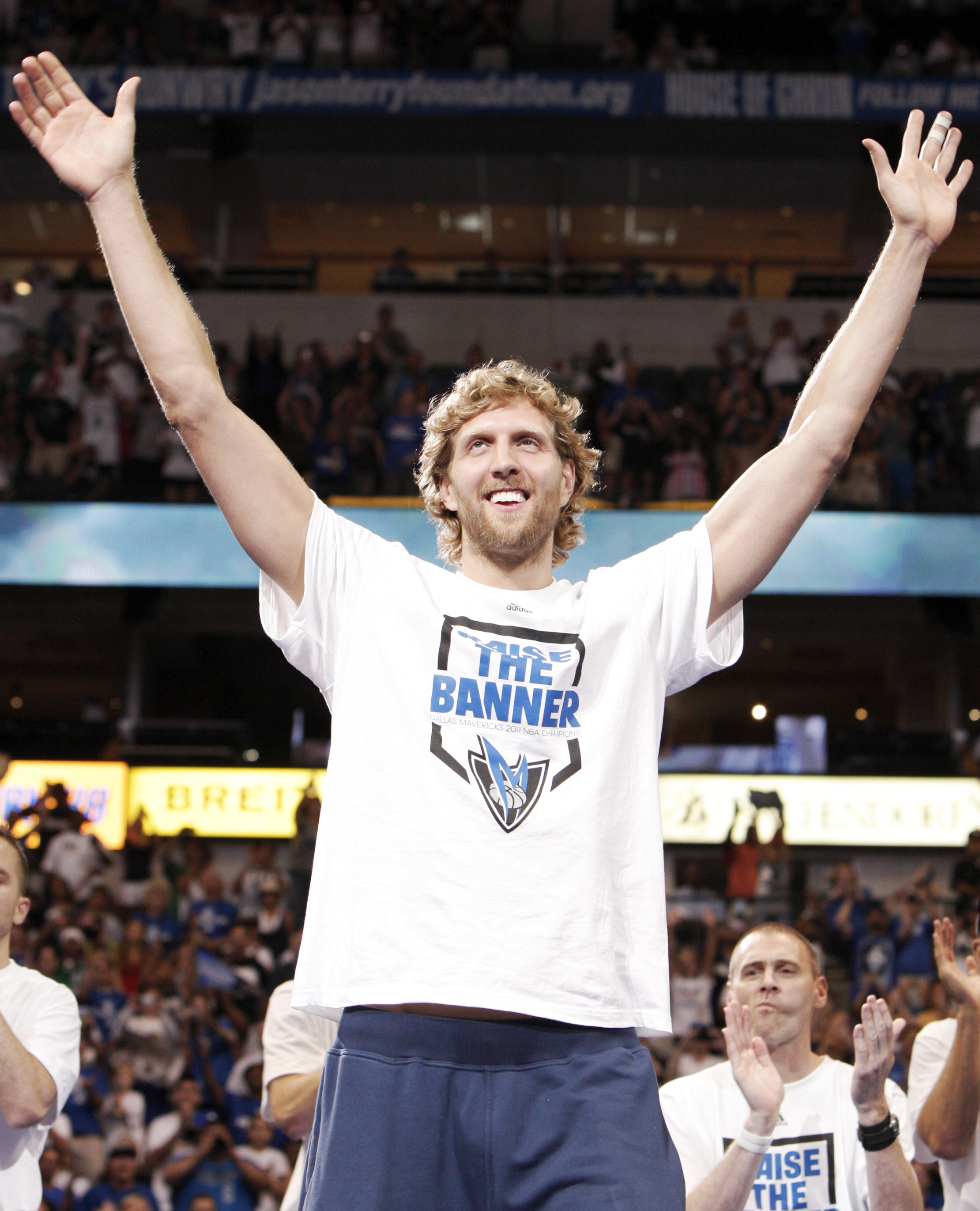 DALLAS, TX - JUNE 16: Forward Dirk Nowitzki of the Dallas Mavericks waves to fans during the Dallas Mavericks Victory celebration on June 16, 2011 in Dallas, Texas. (Photo by Brandon Wade/Getty Images)