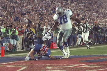 31 Jan 1993: Wide receiver Don Beebe of the Buffalo Bills (left) forces a fumble on defensive tackle Leon Lett of the Dallas Cowboys during Super Bowl XXVII at the Rose Bowl in Pasadena, California. The Cowboys won the game, 52-17.