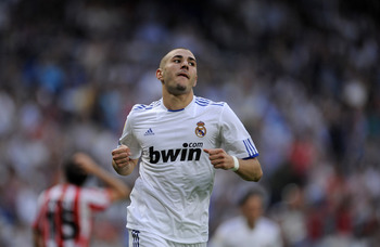 MADRID, SPAIN - MAY 21:  Karim Benzema of Real Madrid celebrates after scoring Real's third goal during the La Liga match between Real Madrid and UD Almeria at Estadio Santiago Bernabeu on May 21, 2011 in Madrid, Spain.  (Photo by Denis Doyle/Getty Images