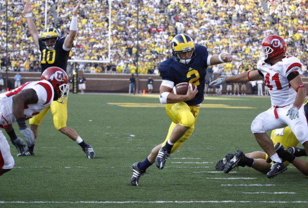 ANN ARBOR, MI - AUGUST 30:  Sam McGuffie #2 of the Michigan Wolverines runs for a fourth quarter touchdown past Koa Misi #41 with Steven Threet #10 celebrating in the background on August 30, 2008 at Michigan Stadium in Ann Arbor, Michigan. Utah won the g