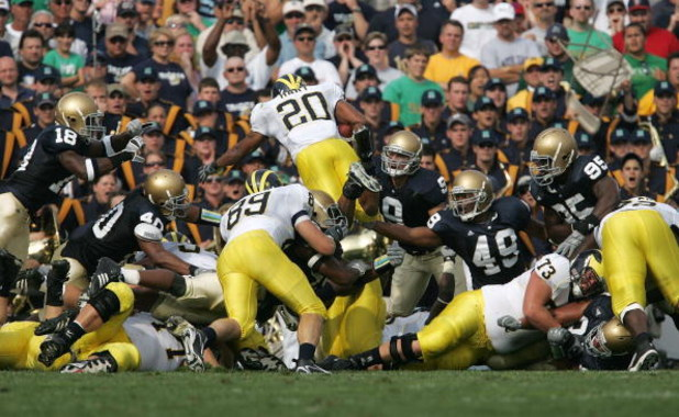 SOUTH BEND, IN - SEPTEMBER 16:  Mike Hart #20 of the Michigan Wolverines dives over the pile for a touchdown against the Notre Dame Fighting Irish September 16, 2006 at Notre Dame Stadium in South Bend, Indiana.  (Photo by Jonathan Daniel/Getty Images)
