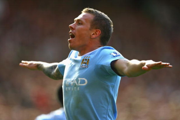 MANCHESTER, ENGLAND - SEPTEMBER 20:  Craig Bellamy of Manchester City celebrates scoring his team's second goal during the Barclays Premier League match between Manchester United and Manchester City at Old Trafford on September 20, 2009 in Manchester, Eng