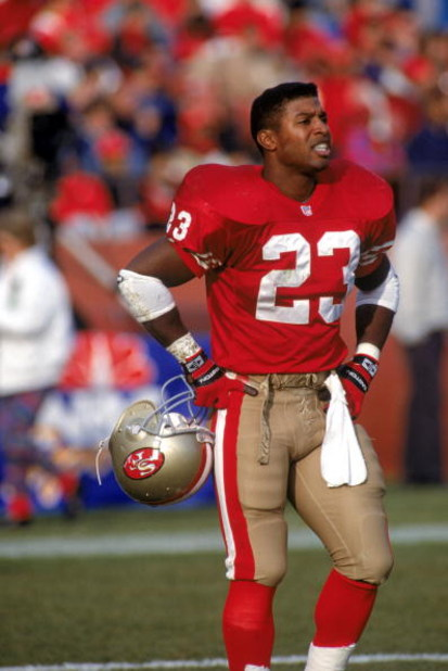 SAN FRANCISCO - DECEMBER 14:  Spencer Tillman #23 of the San Francisco 49ers stands on the field during a game against the Kansas City Chiefs at Candlestick Park on December 14, 1991 in San Francisco, California.  The 49ers won 28-14.  (Photo by George Ro