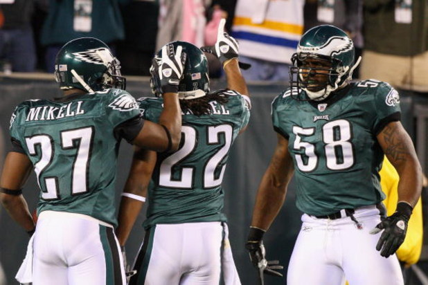 PHILADELPHIA - DECEMBER 15:  Asante Samuel #22 of the Philadelphia Eagles celebrates with Quintin Mikell #27 and Trent Cole #58 after an interception for a touchdown against the Cleveland Browns on December 15, 2008 at Lincoln Financial Field in Philadelp