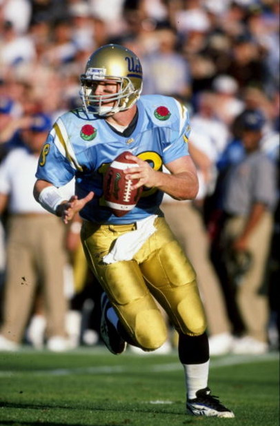 1 Jan 1999:  Quarterback Cade McNown #18 of the UCLA Bruins in action during the Rose Bowl Game against the Wisconsin Badgers at the Rose Bowl in Pasadena, California. The Badgers defeated the Bruins 38-31. Mandatory Credit: Tom Hauck  /Allsport