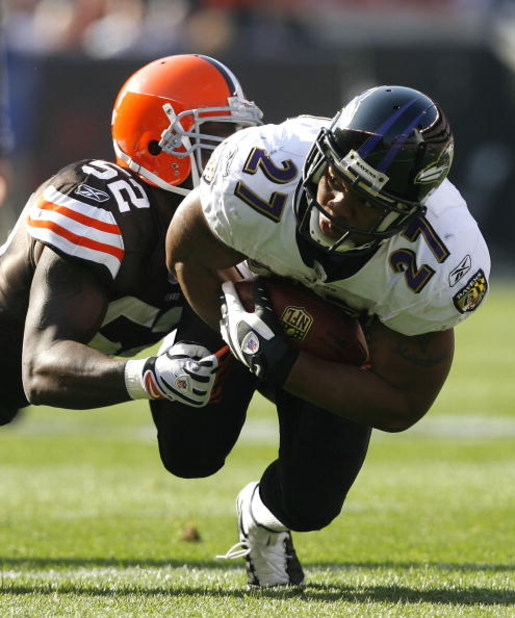 CLEVELAND - NOVEMBER 2:  Ray Rice #27 of the Baltimore Ravens runs the ball as he is hit by D'Qwell Jackson #52 of the Cleveland Browns during the second quarter of their NFL game at Cleveland Browns Stadium November 2, 2008 in Cleveland, Ohio.  (Photo by