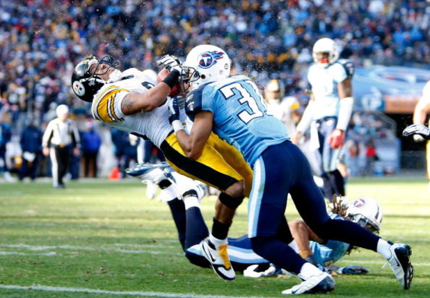 NASHVILLE, TN - DECEMBER 21:  Hines Ward #86 of the Pittsburgh Steelers is hit hard by Cortland Finnegan #31 of the Tennessee Titans as he scores a touchdown during their game on December 21, 2008 at LP Field in Nashville, Tennessee.  (Photo by Streeter L