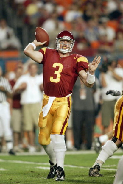MIAMI - JANUARY 2:  Quarterback Carson Palmer #3 of USC passes against Iowa during the FedEx Orange Bowl at Pro Player Stadium on January 2, 2003 in Miami, Florida.  The University of Southern California Trojans defeated the Iowa Hawkeyes 38-17.  (Photo b