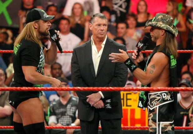 LAS VEGAS - AUGUST 24:  (L-R) Wrestler Triple H, World Wrestling Entertainment Inc. Chairman Vince McMahon and wrestler Shawn Michaels appear in the ring during the WWE Monday Night Raw show at the Thomas & Mack Center August 24, 2009 in Las Vegas, Nevada