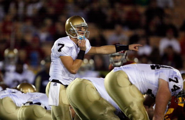 LOS ANGELES, CA - NOVEMBER 29:  Jimmy Clausen #7 of the Notre Dame Fighting Irish calls a play against the USC Trojans during the game at the Coliseum on November 29, 2008 in Los Angeles, California.  (Photo by Harry How/Getty Images)