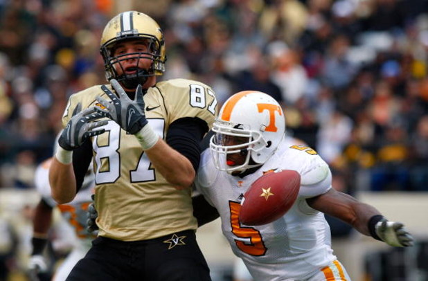 NASHVILLE, TN - NOVEMBER 22:  Linebacker Rico McCoy #5 of the Tennessee Volunteers breaks up a pass intended for tight end Brandon Barden #87 of the Vanderbilt Commodores during the game at Vanderbilt Stadium on November 22, 2008 in Nashville, Tennessee.