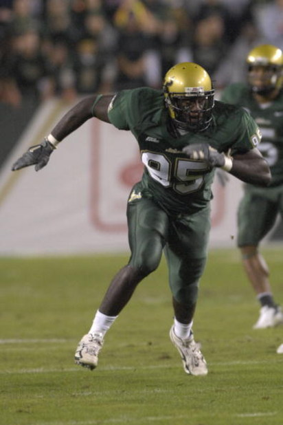 TAMPA, FL - NOVEMBER 17: Defensive end George Selvie #95 of the University of South Florida Bulls sets for play against the Louisville Cardinals at Raymond James Stadium on November 17, 2007 in Tampa, Florida.  South Florida won 55-17.  (Photo by Al Messe