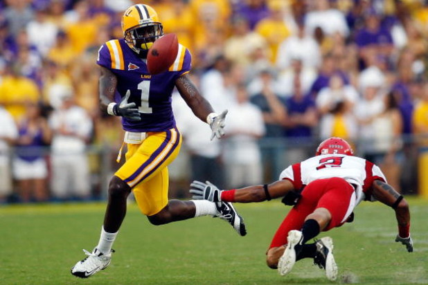 BATON ROUGE, LA - SEPTEMBER 19:  Brandon LaFell #1 of the Louisiana State University Tigers bobbles a ball over defender Orkeys Auriene #2 of the University of Louisiana-Lafatette Ragin' Cajuns at Tiger Stadium on September 19, 2009 in Baton Rouge, Louisi