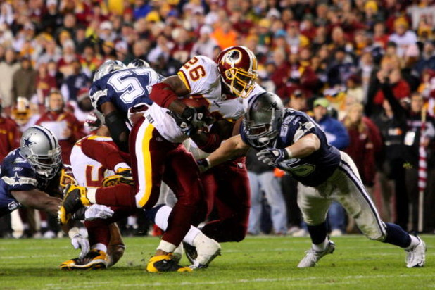 LANDOVER, MD - NOVEMBER 16:  Clinton Portis #26 of the Washington Redskins runs against Zach Thomas #55 of the Dallas Cowboys during the first quarter of their game on November 16, 2008 at FedEx Field in Landover, Maryland.  (Photo by Jim McIsaac/Getty Im