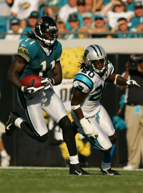 JACKSONVILLE, FL - DECEMBER 09:  Reggie Williams #11 of the Jacksonville Jaguars runs in a game against the Carolina Panthers at Jacksonville Municipal Stadium on December 9, 2007 in Jacksonville, Florida.  The Jagaurs beat the Panthers 37-6.  (Photo by S