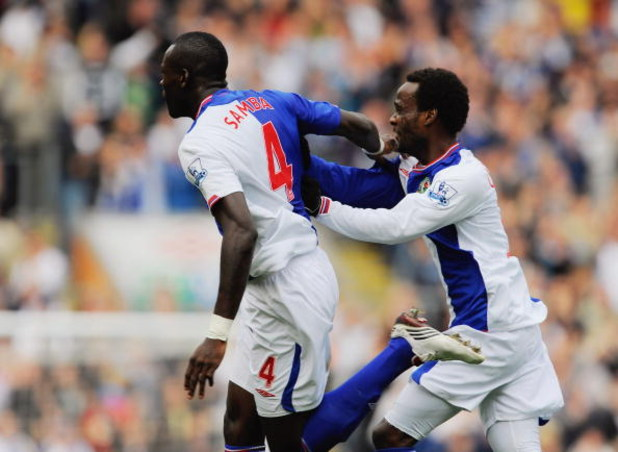 BLACKBURN, ENGLAND - SEPTEMBER 26:  Chris Samba of Blackburn celebrates scoring to make it 1-1 with team mate Pascal Chimbonda during the Barclays Premier League match between Blackburn Rovers and Aston Villa at Ewood Park on September 26, 2009 in Blackbu