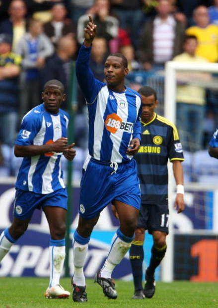 WIGAN, ENGLAND - SEPTEMBER 26:  Titus Bramble of Wigan Athletic celebrates scoring during the Barclays Premier League match between Wigan Athletic and Chelsea at DW Stadium on September 26, 2009 in Wigan, England.  (Photo by Phil Cole/Getty Images)