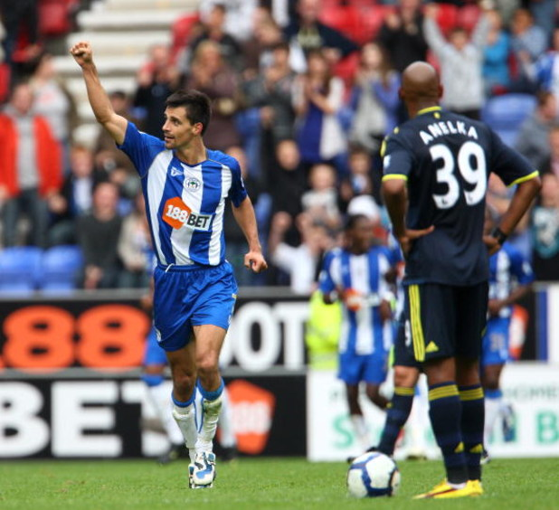 WIGAN, ENGLAND - SEPTEMBER 26: Paul Scharner of Wigan Athletic celabrates scoring during the Barclays Premier League match between Wigan Athletic and Chelsea at DW Stadium on September 26, 2009 in Wigan, England.  (Photo by Phil Cole/Getty Images)