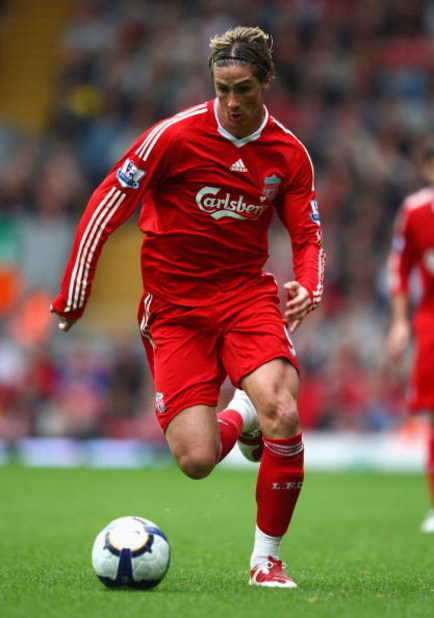 LIVERPOOL, ENGLAND - SEPTEMBER 26:  Fernando Torres of Liverpool in action during the Barclays Premier League match between Liverpool and Hull City at Anfield on September 26, 2009 in Liverpool, England.  (Photo by Clive Brunskill/Getty Images)