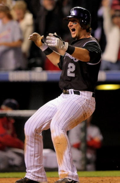 DENVER - SEPTEMBER 25:  Shortstop Troy Tulowitzki #2 of the Colorado Rockies celibrates after scoring the game-winning run against the St. Louis Cardinals on a sacrifice fly by Yorvit Torrealba in the ninth inning at Coors Field on September 25, 2009 in D
