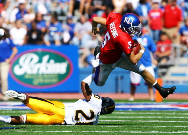 LAWRENCE, KS - SEPTEMBER 26:  Quarterback Todd Reesing #5 of the Kansas Jayhawks evades C.J. Bailey #20 of the Southern Mississippi Golden Eagles during the game on September 26, 2009 at Memorial Stadium in Lawrence, Kansas.  (Photo by Jamie Squire/Getty