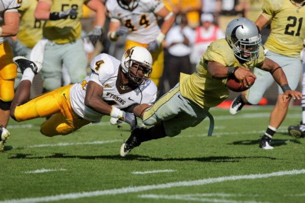 BOULDER, CO - SEPTEMBER 19:  Running back Rodney Stewart #5 of the Colorado Buffaloes dives into the endzone as Tashaun Gipson #4 of the Wyoming Cowboys attempts to make the stop at Folsom Field on September 19, 2009 in Boulder, Colorado. Stewart's third