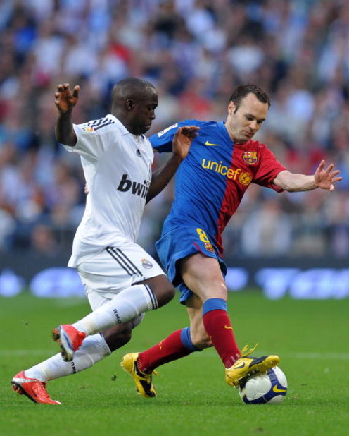 MADRID, SPAIN - MAY 02:  Andres Iniesta (R) of Barcelona duels for the ball with Lass Diarra of Real Madrid during the La Liga match between Real Madrid and Barcelona at the Santiago Bernabeu Stadium on May 2, 2009 in Madrid, Spain. Barcelona won the matc