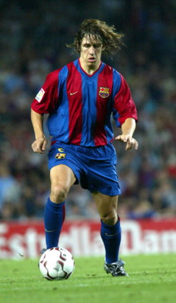 BARCELONA, SPAIN - SEPTEMBER 1:   Carlos Puyol of Barcelona in action during the Primera Liga match between Barcelona and Atletico Madrid, played at the Camp Nou Stadium, Barcelona, Spain on September 1, 2002.  (Photo Firo Foto/Getty Images)