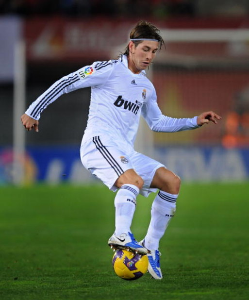 PALMA, SPAIN - JANUARY 11:  Sergio Ramos of Real Madrid controls the ball during the La Liga match betwen Mallorca and Real Madrid at the San Moix stadium on January 11, 2009 in Palma, Spain.  (Photo by Denis Doyle/Getty Images)
