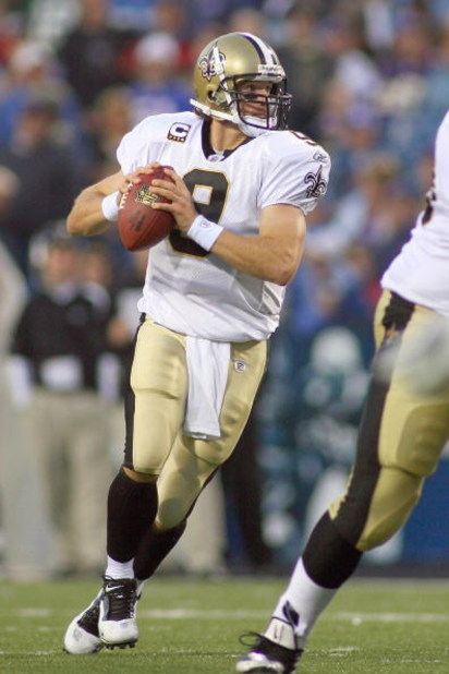 ORCHARD PARK, NY - SEPTEMBER 27:  Quarterback Drew Brees #9 of the New Orleans Saints moves to pass the ball during the game against the Buffalo Bills at Ralph Wilson Stadium on September 27, 2009 in Orchard Park, New York. The Saints won 27-7. (Photo by