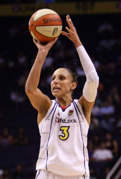 PHOENIX - SEPTEMBER 29:  Diana Taurasi #3 of the Phoenix Mercury puts up a three point shot against the Indiana Fever in Game One of the 2009 WNBA Finals at US Airways Center on August 29, 2009 in Phoenix, Arizona. The Mercury defeated the Fever 120-116 i