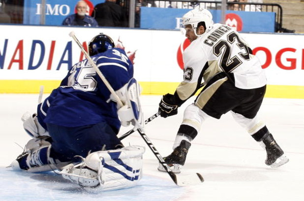 TORONTO - SEPTEMBER 22:  Chris Conner #23 of the Pittsburgh Penguins scores on goalie Vesa Toskala #35 of the Toronto Maple Leafs during a pre-season  NHL game at the Air Canada Centre on September 22, 2009 in Toronto, Ontario, Canada .  (Photo by Abelima