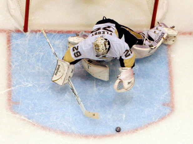 DETROIT - JUNE 12:  Marc-Andre Fleury #29 of the Pittsburgh Penguins makes a save against the Detroit Red Wings during Game Seven of the 2009 NHL Stanley Cup Finals at Joe Louis Arena on June 12, 2009 in Detroit, Michigan.  (Photo by Jim McIsaac/Getty Ima